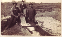 Hank Buhler near a new groundwater pump in 190