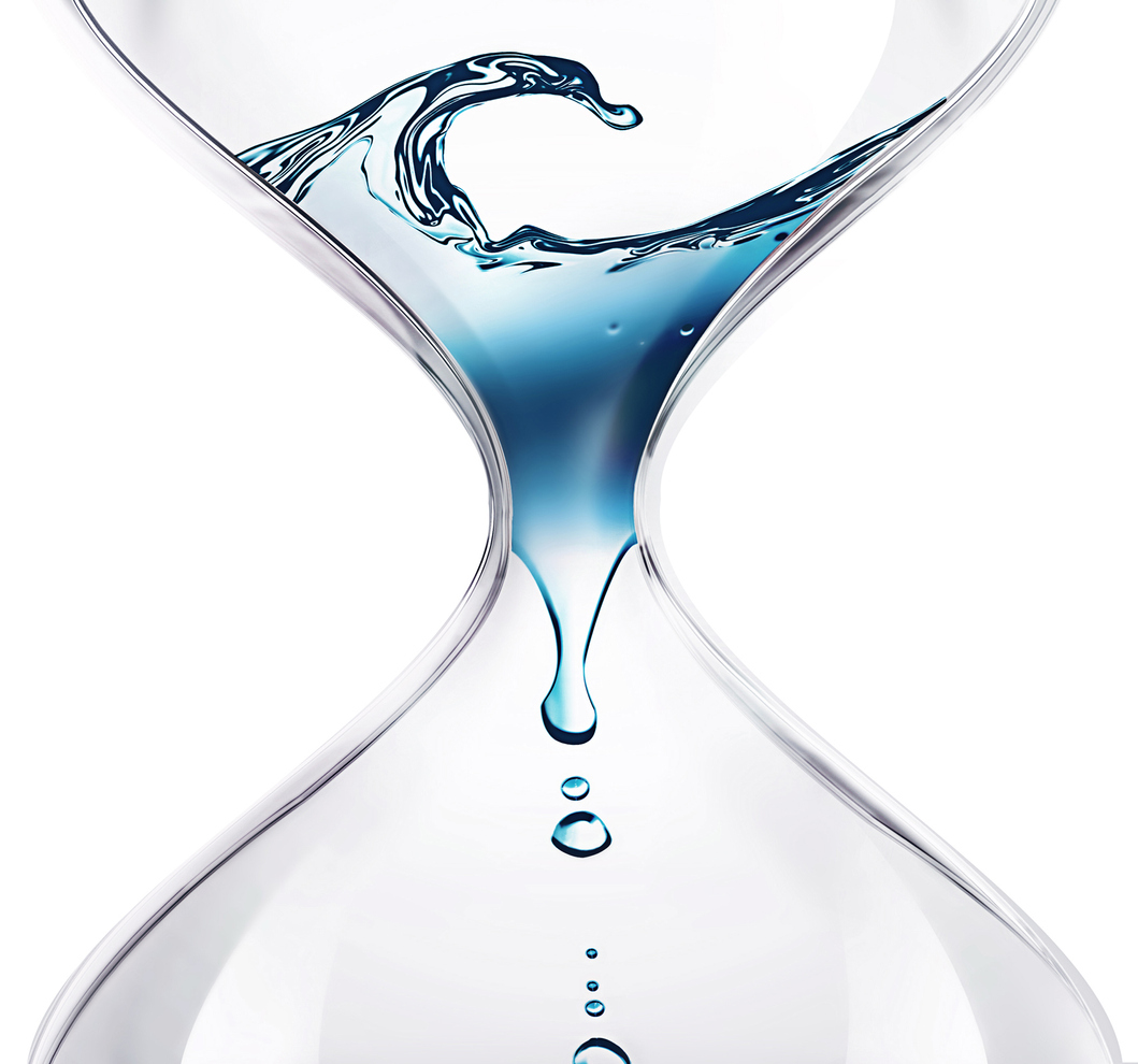 hourglass with dripping water close-up