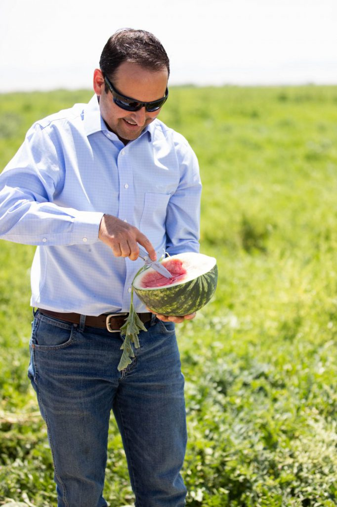 Derek Azevedo of Bowles Farming shares melon fresh-from-the-field.